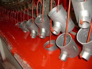 На фото - производство трубных изделий из чугуна, nevapipe.ru