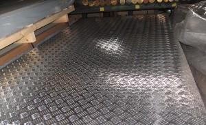 Производство стального рифленого листа 5 мм фото