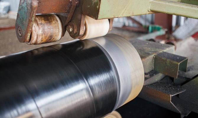 Какие основные достоинства имеет стальная труба с покрытием ВУС? фото