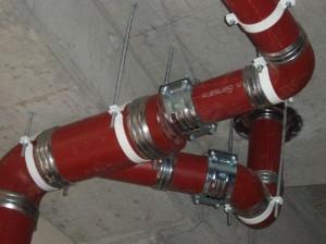 Фото монтажа чугунных безраструбных труб, thermosystem.ru