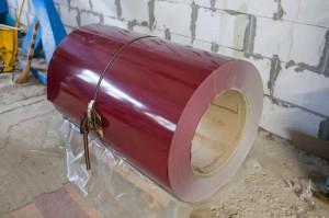 На фото - оцинкованный рулон с полимерным покрытием, lion-steel.com.ua